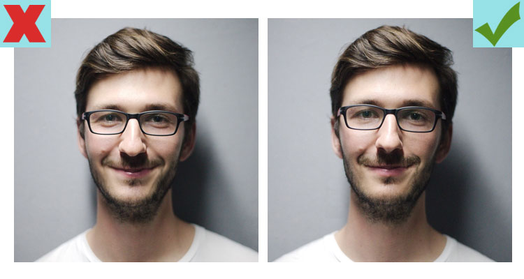 Keep your smile understated to look smarter in photos